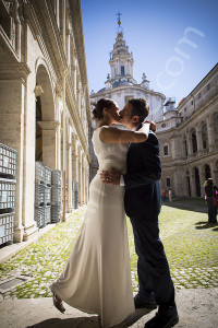 Wedding couple kissing at S. Ivo alla Sapienza in Rome Italy