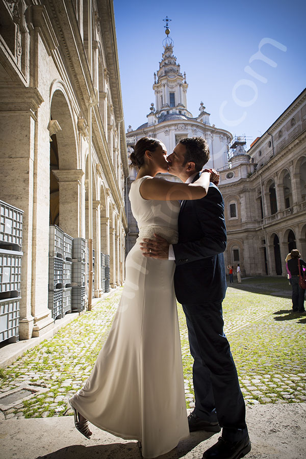 Wedding bride and groom kissing at S. Ivo alla Sapienza
