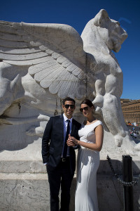 Couple posing for a wedding photo on the Vittoriano monument in Rome Italy