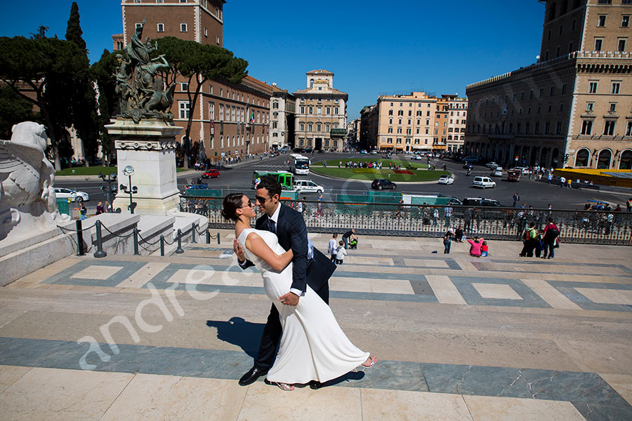 Man dipping wife during their shoot. Piazza Venezia.