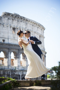 Wedding couple photographed at the Roman Colosseum in Rome Italy