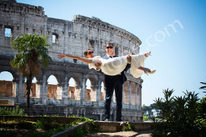 Man holding wife after wedding in Rome