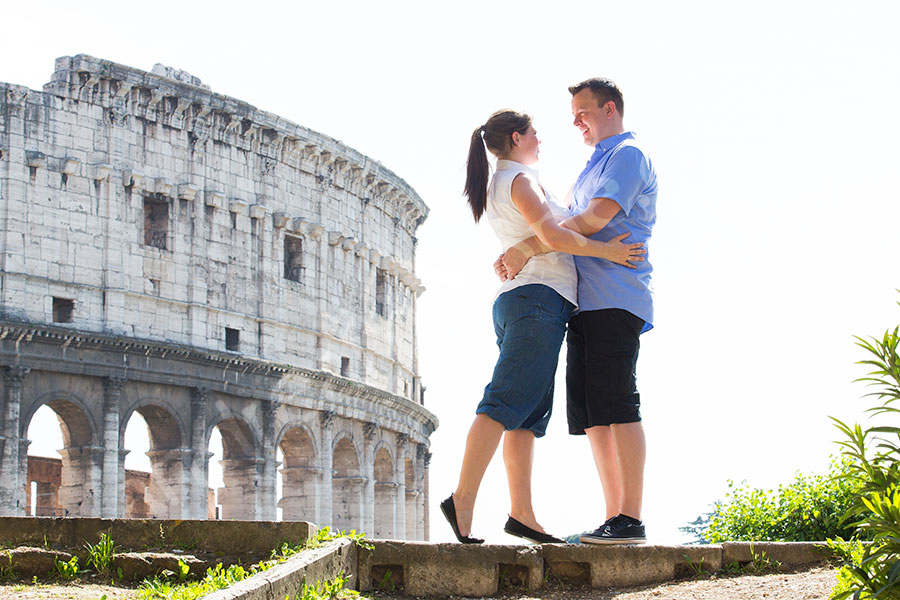 Couple holding each other close. Roman Coliseum. Rome Italy