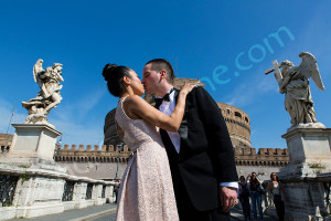 Close up kissing couple in Rome at Castel Sant'Angelo
