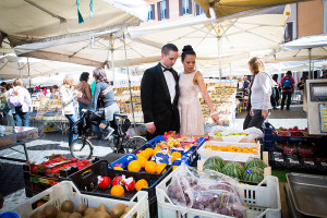 Couple visiting the fruit and vegetable market in Piazza Giordano Bruno during a photo shoot