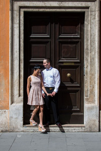 Couple standing together in front of a doorway in Rome Italy