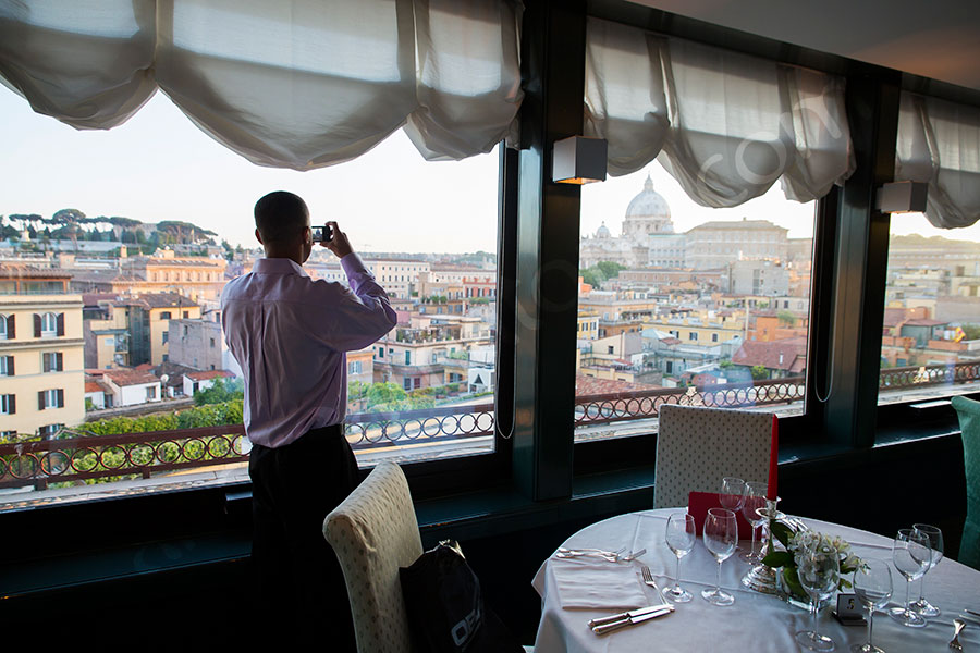 Surprise wedding marriage proposal. Taking a picture of Saint Peter's Dome from a restaurant.