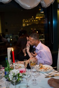 Couple kissing at a restaurant in Rome