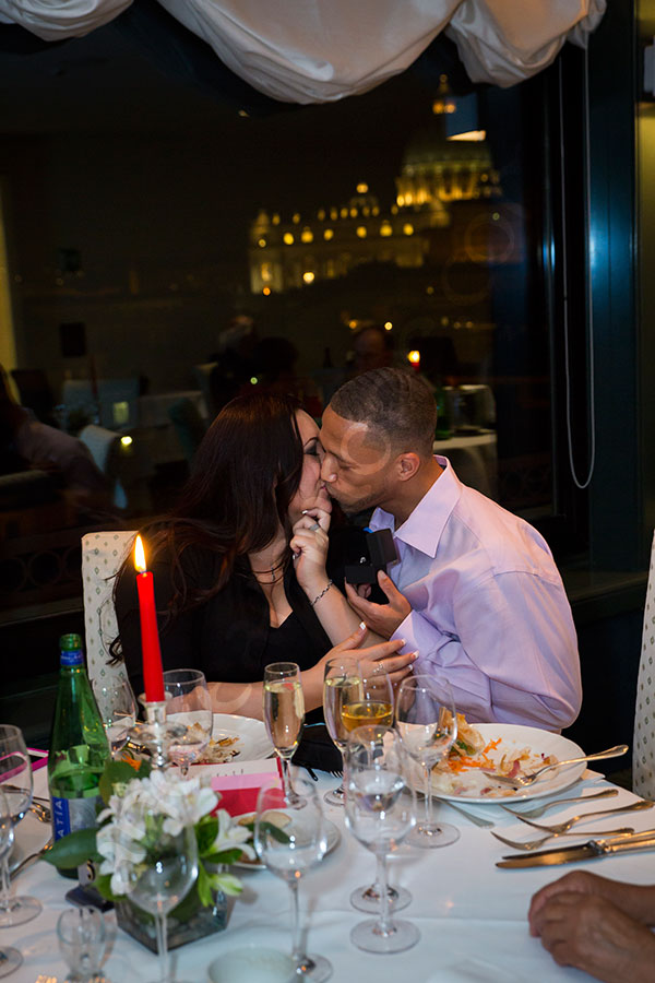 Couple kissing at a restaurant after engaged to be married
