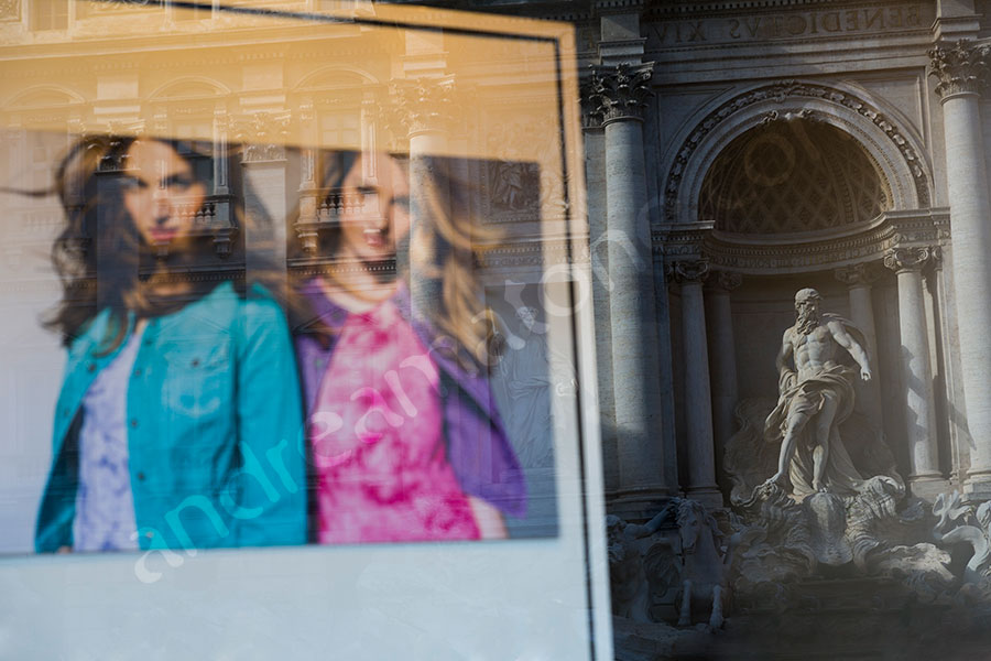 Fashion photographer window reflection of the Trevi