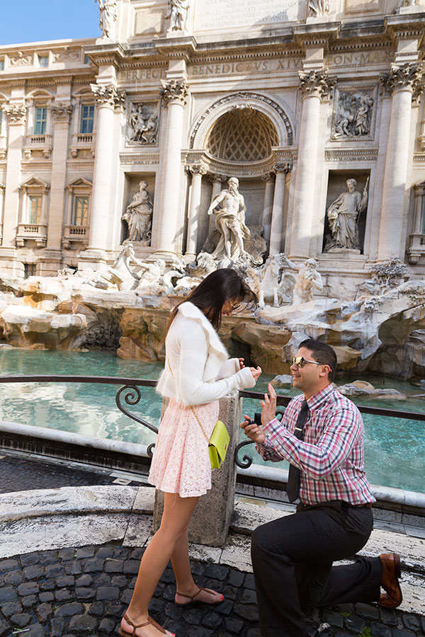 Surprise engagement photography. Proposing at the Trevi.