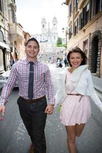 Engaged couple happily walking on Via Condotti in Rome