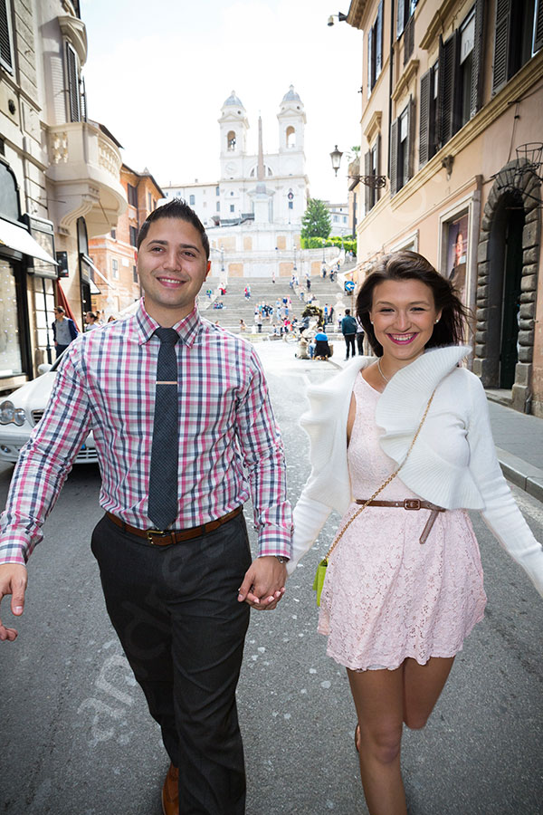 Engaged couple happily walking on Via Condotti