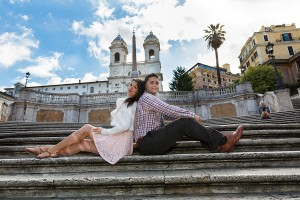 Couple sitting down on the steps of Trinita' dei Monti in Rome