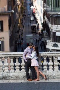 Picture taken by a photographer from a far of a couple in Rome
