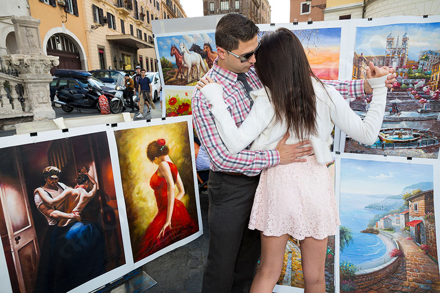Dancing in front of paintings in Rome Italy