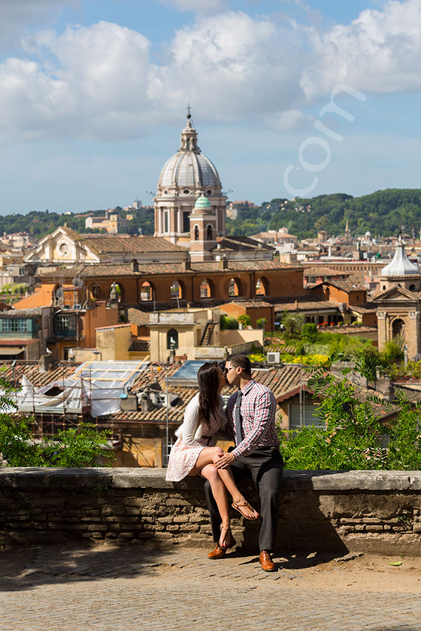 Couple kissing at Parco del Pincio in Rome Italy