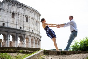Couple having fun at the Coliseum in Rome