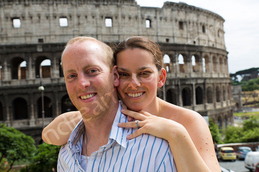 Close up portrait of a honeymoon couple by the Coliseum