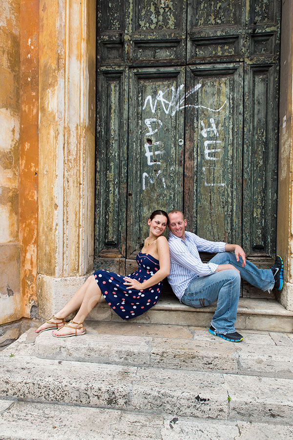 Picture portrait in front of an old door in the roman streets