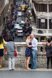Couple together photographed at Trinita' dei monti overlooking the streets of Rome