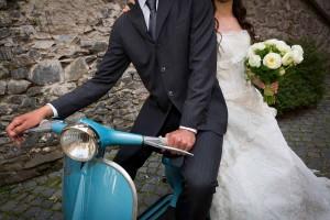 Wedding photography session on an Italian Vespa motoscooter
