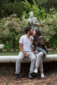 Couple kissing on the water fountain in Villa Borghese in Rome