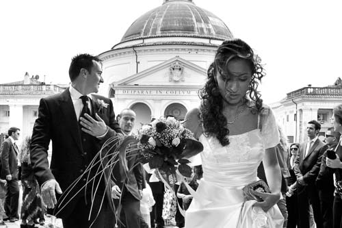 Bride and groom in front of church after a civil matrimony in Ariccia