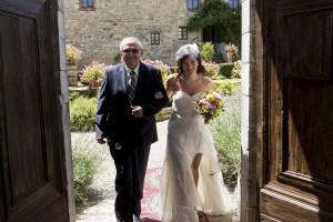 Bride makes the entrance in Castello di Spaltenna in Gaiole in Chianti Tuscany Italy