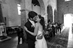 Bride and groom kiss after exchanging rings