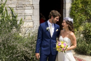 Bride and groom smile at each other just outside Church Castello di Spaltenna in Gaiole in Chianti