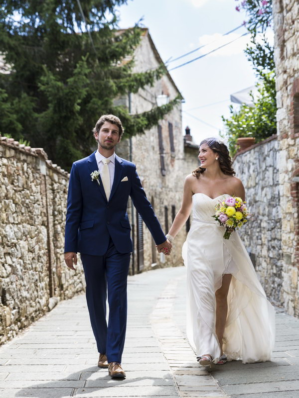 Newlywed couple walking hand in hand