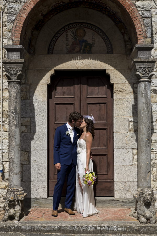 Kissing at the doorsteps of an old Church
