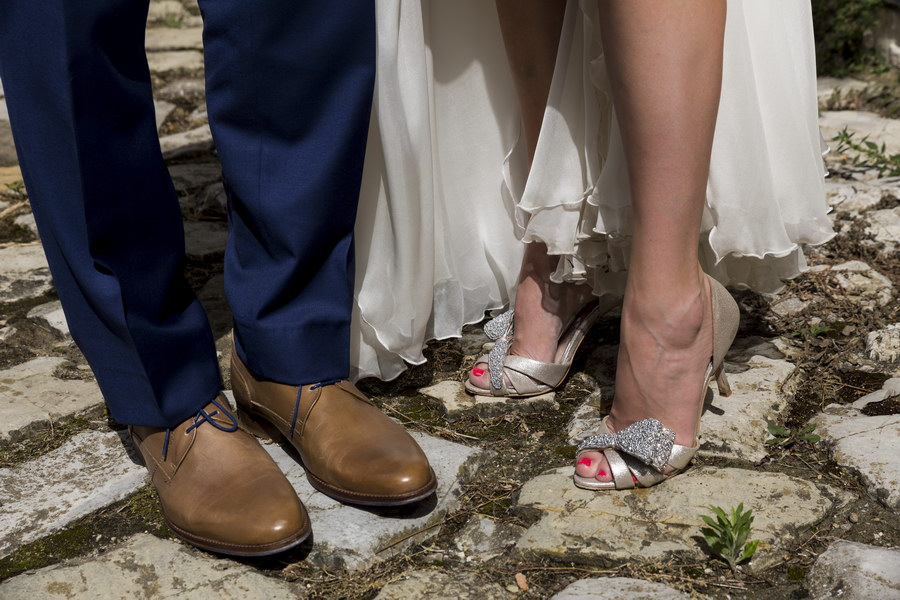 The feet of the newlyweds shoes close up