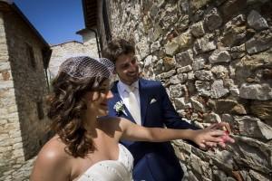 Bride and groom look at their wedding rings
