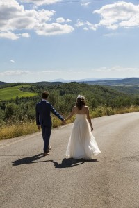 Walking hand in hand on a road in Tuscany Chianti region Italy