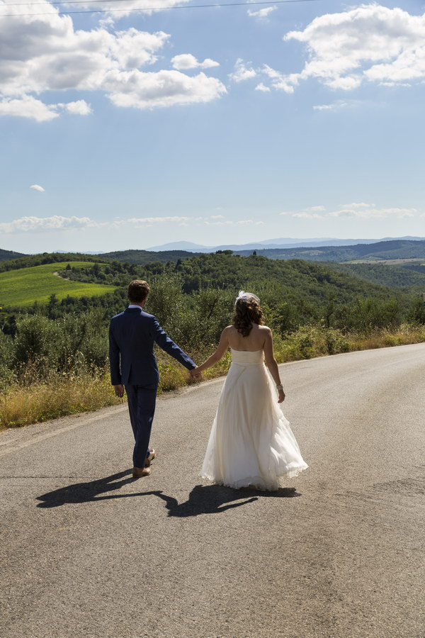 Walking hand in hand on a road in the Chianti region Italy