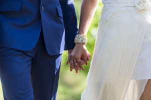 Bride and groom holding hands in a vineyard in Tuscany