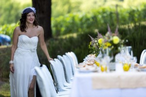Bride photographed next to the wedding dinner table
