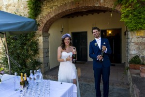 Bride and groom pop opening the wine champagne prosecco