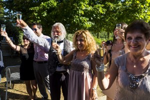Guests toasting to the bride and groom