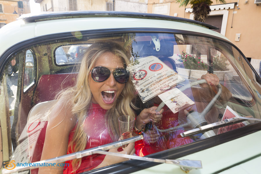 Guests having fun inside a FIAT 500 car