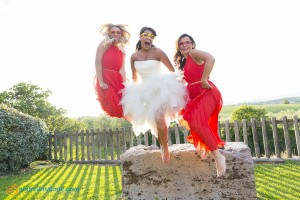Bride jumping in the air with the bride's maids.
