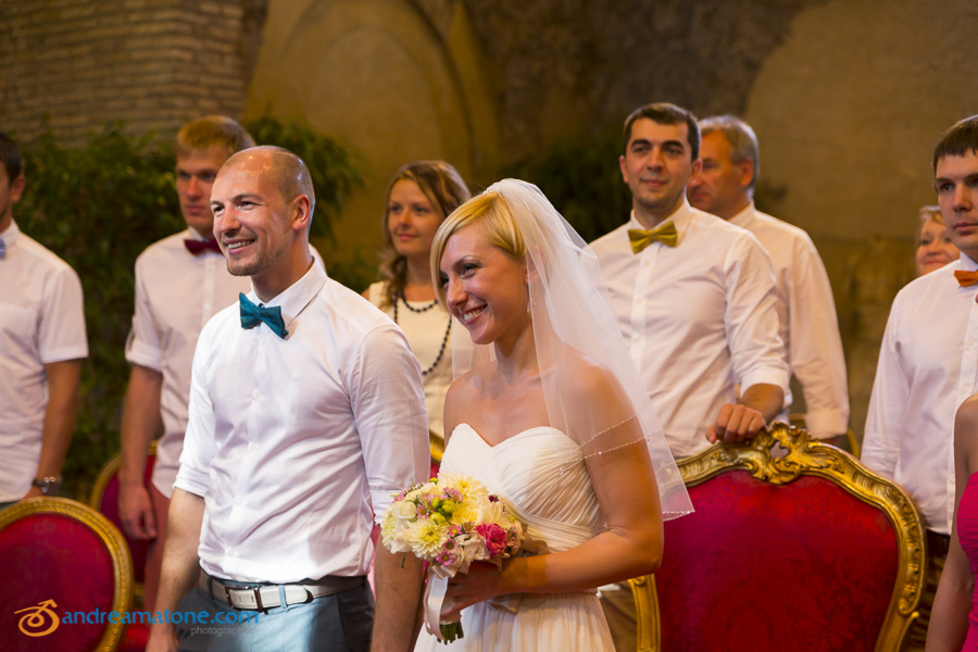 Bride and groom during their civil matrimony ceremony in the roman town hall