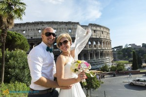 Bride and groom at the Coliseum in Rome Italy