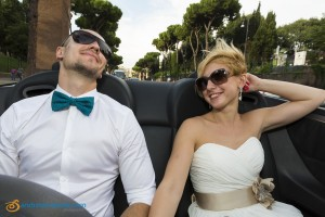 Riding in the back of the wedding car