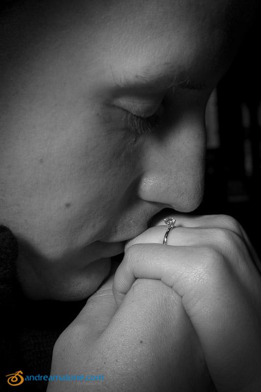 Man kissing engagement ring