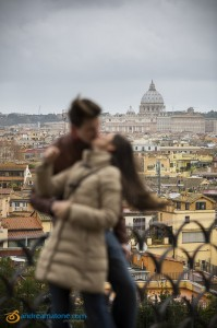 Kissing after a wedding proposal in Rome.