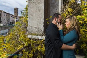 Couple kissing in Rome by the Roman Forum.