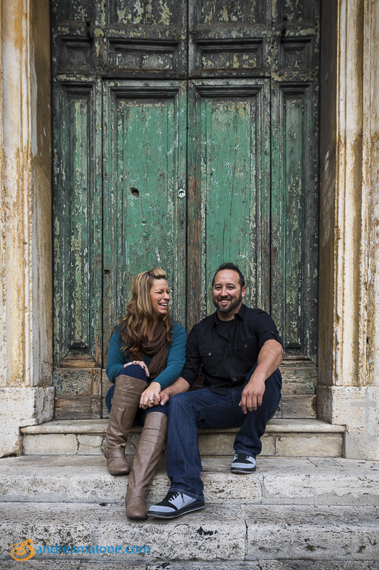 Surprise engagement picture portrait at an old green door.